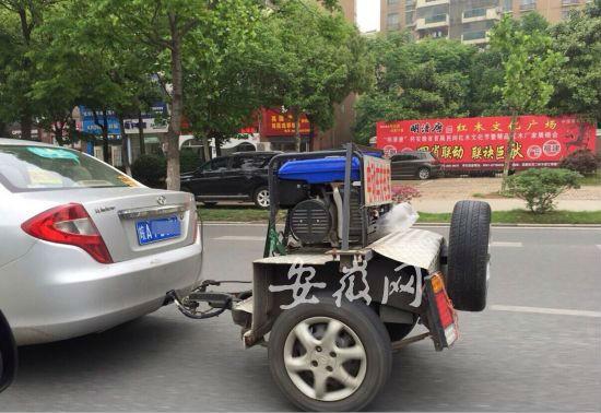 """高手在民间:合肥现自制电动汽车用""""移动充电宝"""""""