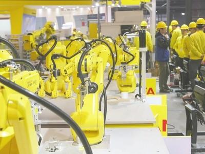 """企业""""砸锅卖铁""""投入机器人 推动产业标准升级"""