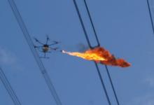 上海电网首次采用喷火无人机进行带电作业